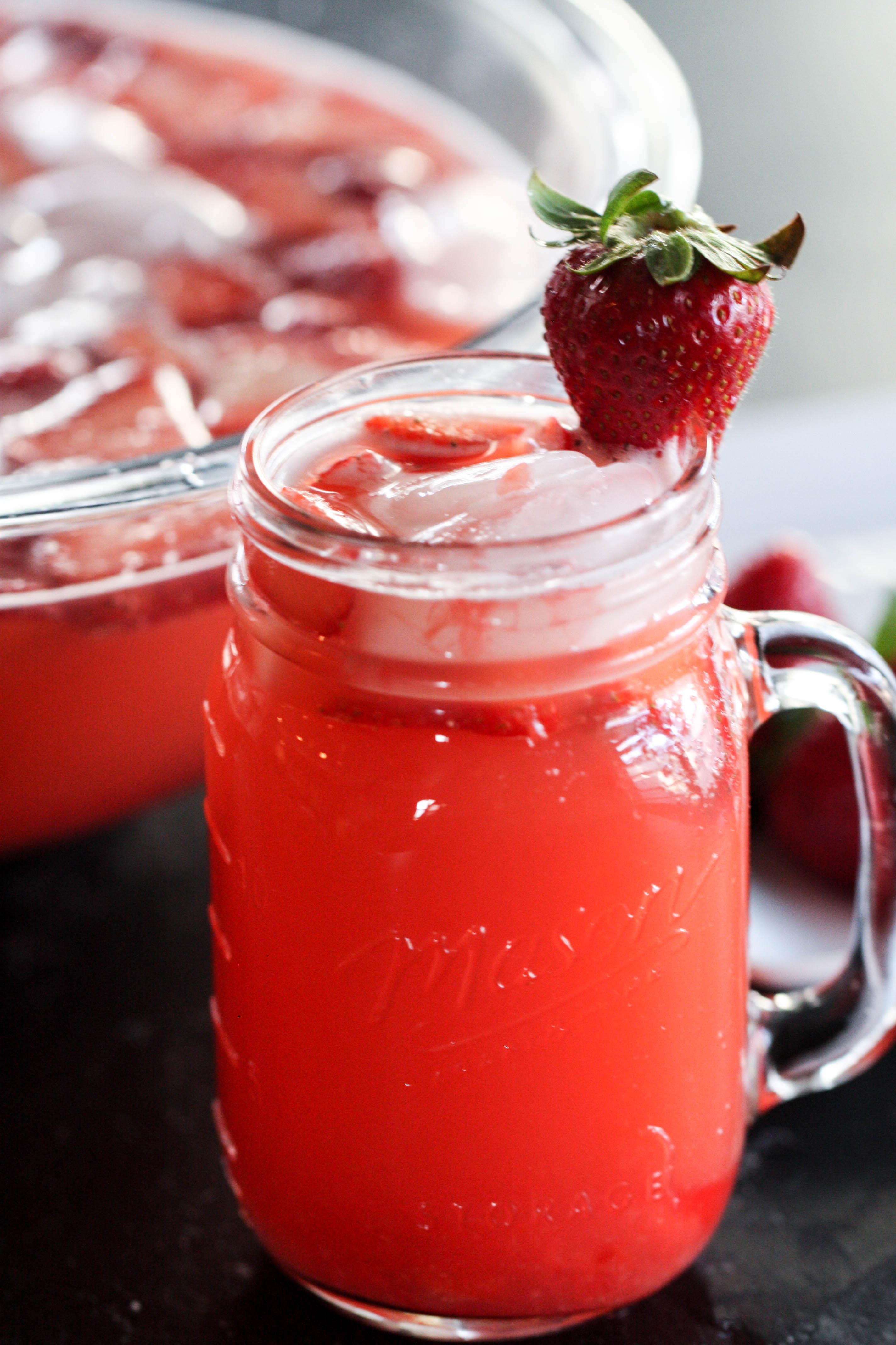Strawberry Slush Drink in a glass mason jar topped with a fresh strawberry