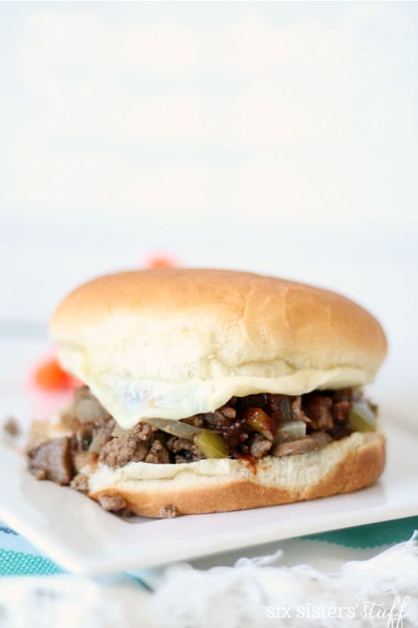philly cheesesteak sloppy joes on a white plate