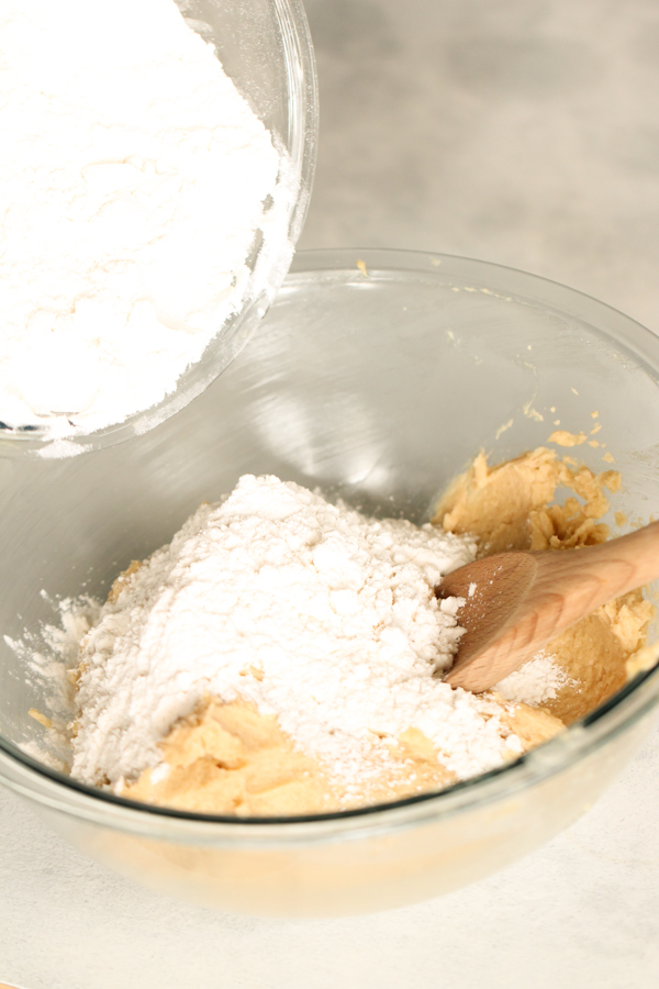 Ingredients for the Chocolate Chip Cookie Bar Layer in a glass bowl