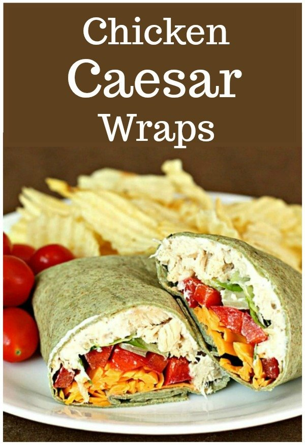 chicken caesar salad wraps served with tomatoes and chips
