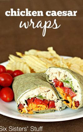 chicken caesar salad wrap cut in half served with chips