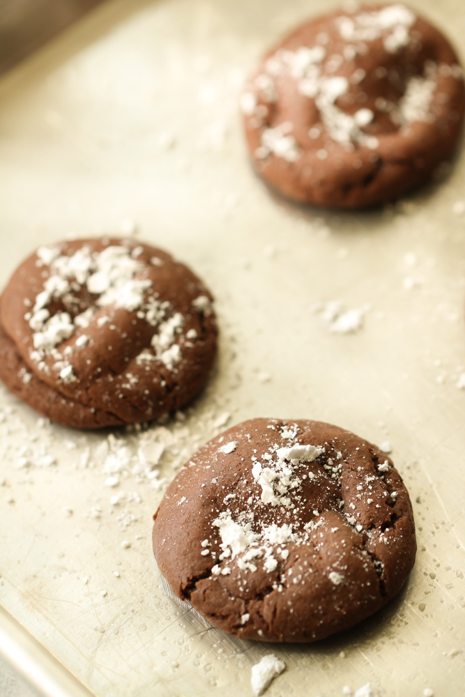 easy rolo cookies recipe fresh out of the oven with powdered sugar on top