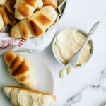 Baked rolls with honey butter for six sisters