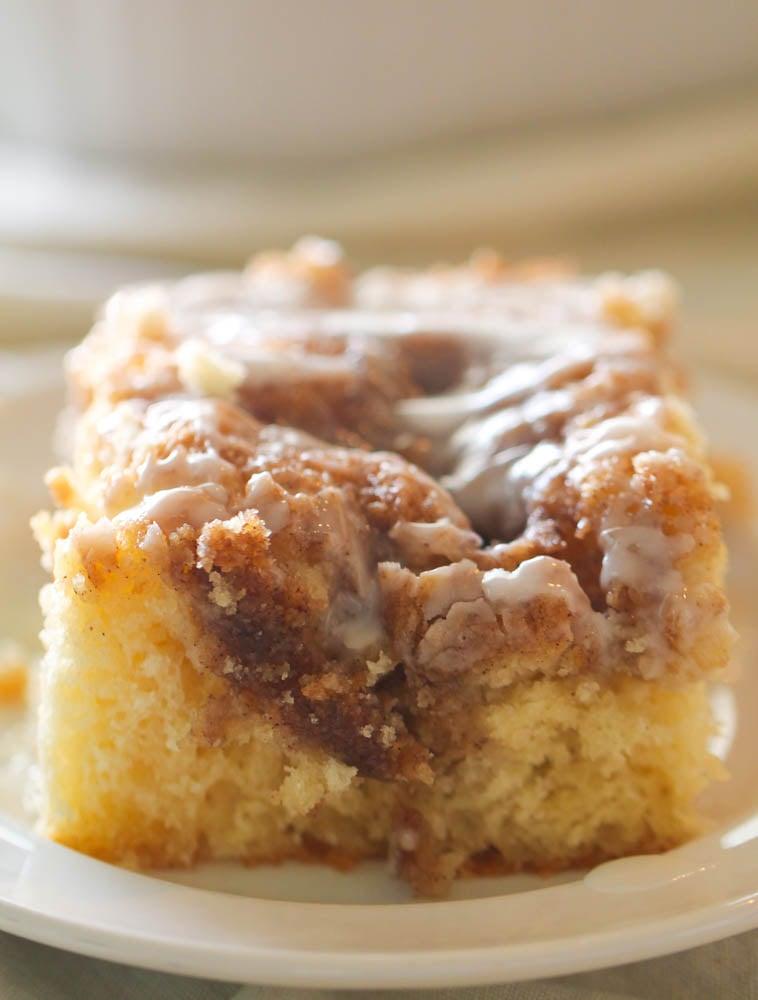 Slice of Cinnabon Cinnamon Roll Cake on a white plate