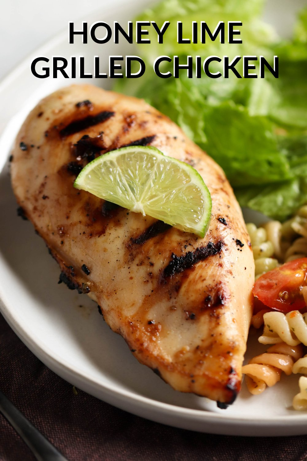 Honey Lime Grilled Chicken on a plate with a side of pasta salad