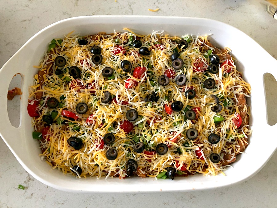 Unbaked Beef and Bean Taco Casserole in white casserole dish