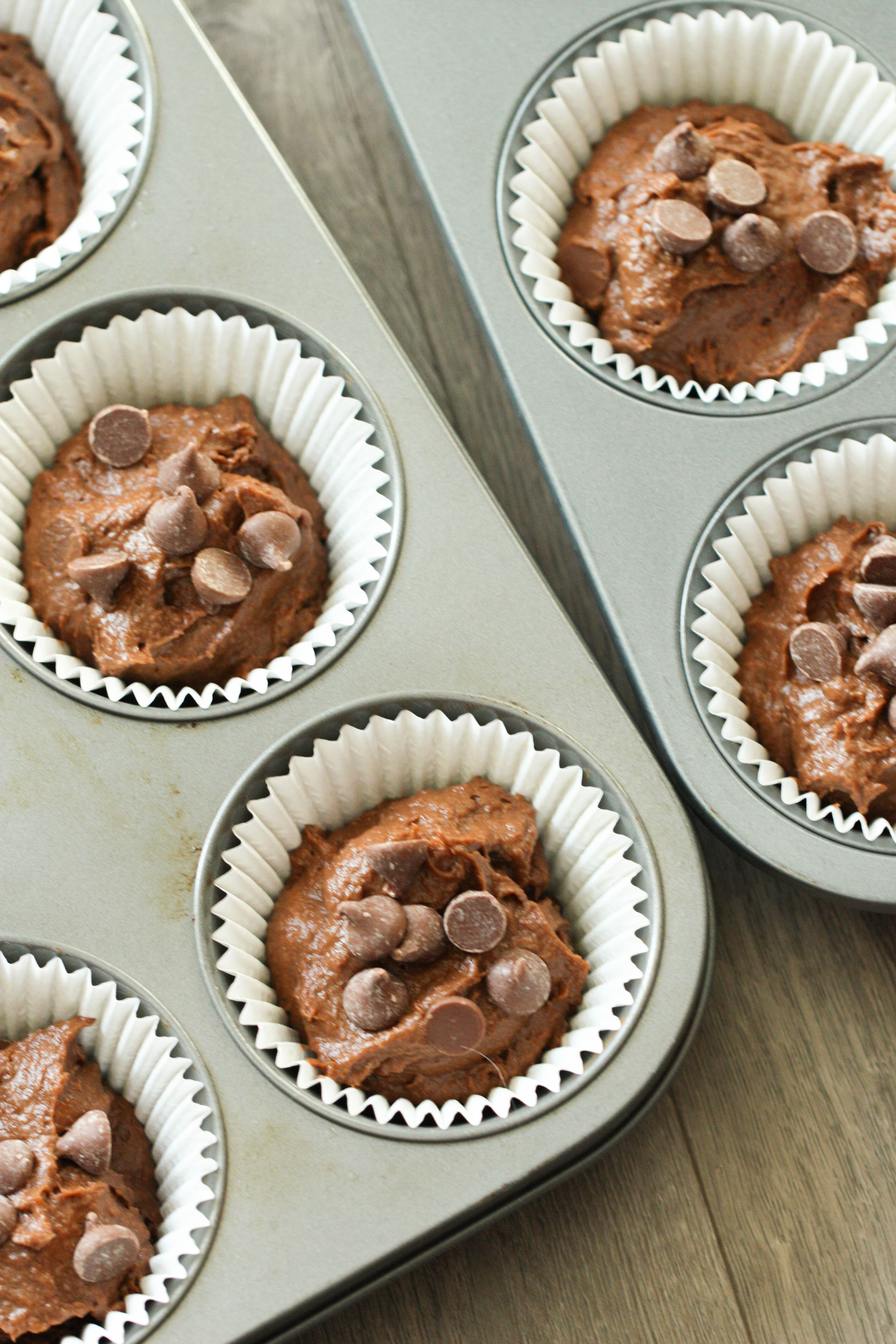 Chocolate Pumpkin Muffins batter in muffin tin