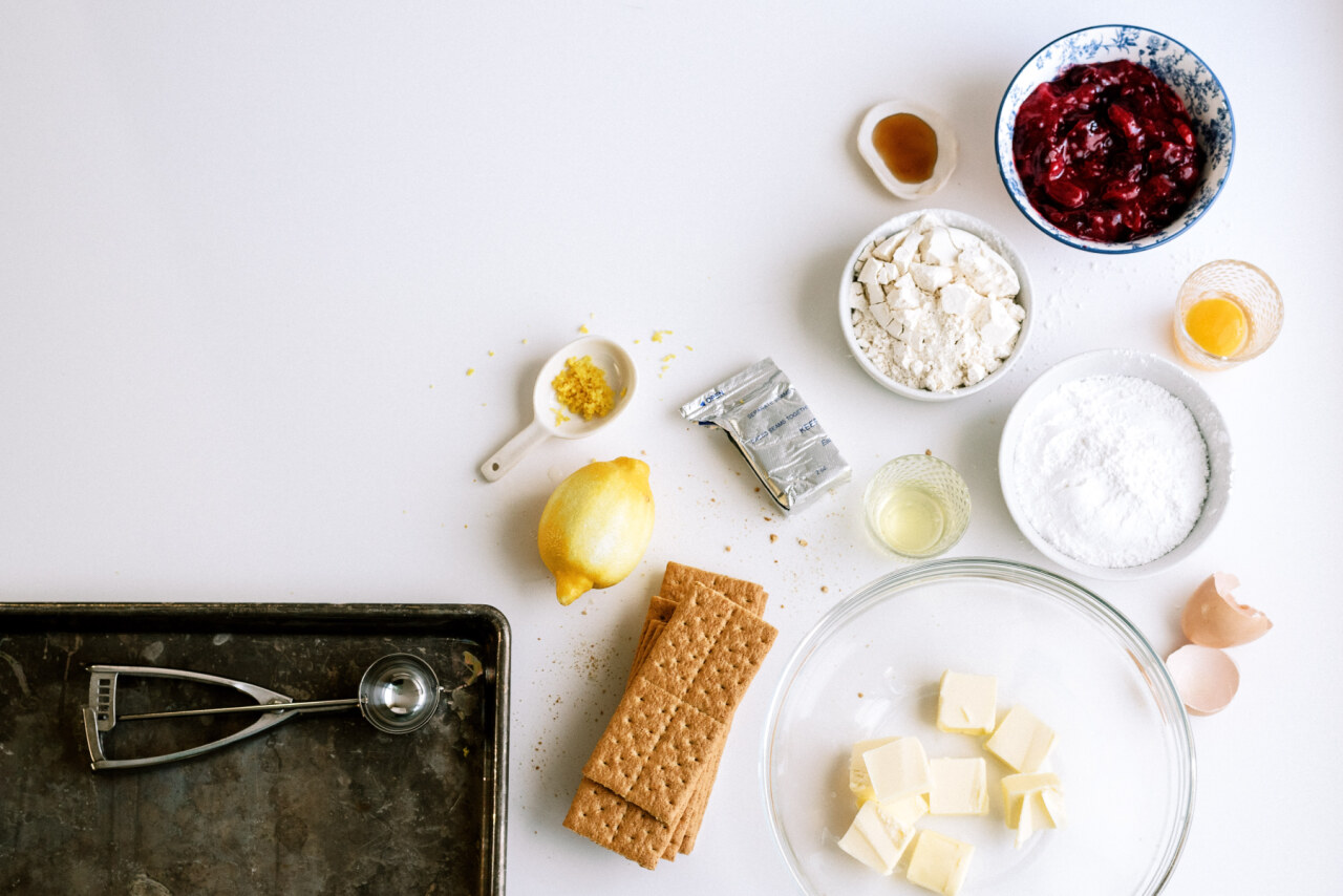Ingredients for Cherry Cheesecake Cookies: lemon zest, butter, graham crackers, egg, powdered sugar, cherry pie filling, flour