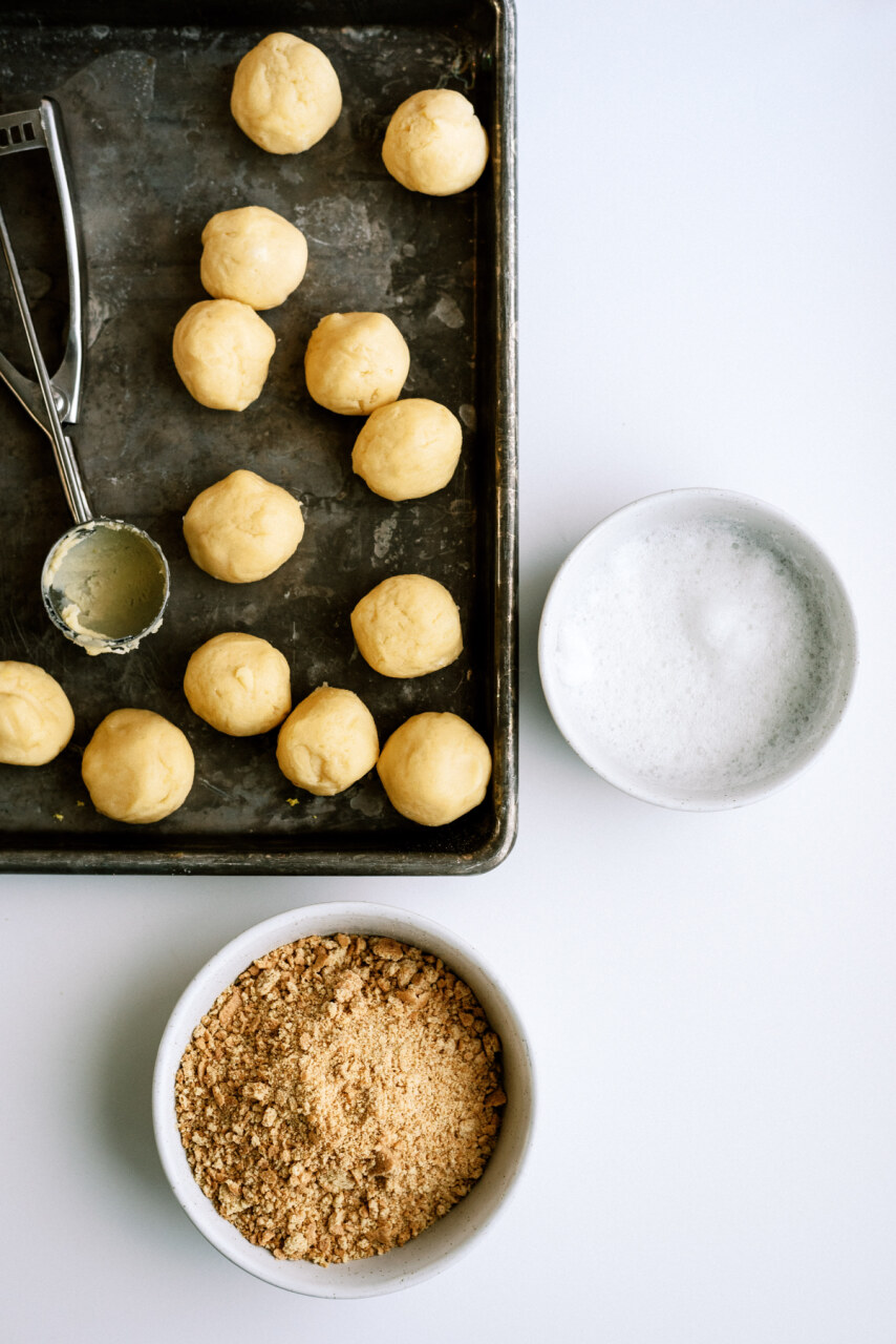 Dough rolled into balls and ready to dip in egg white and graham cracker