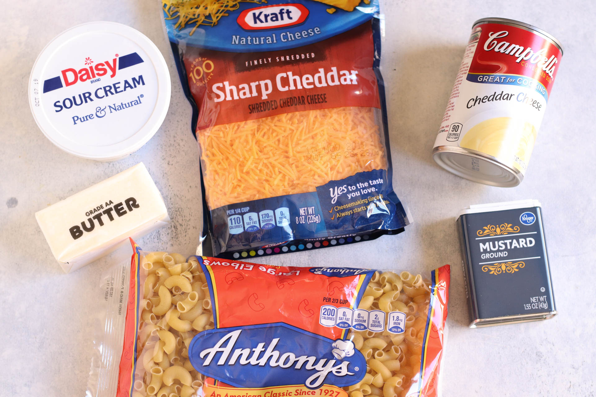 Ingredients in slow cooker macaroni and cheese spread out on the counter