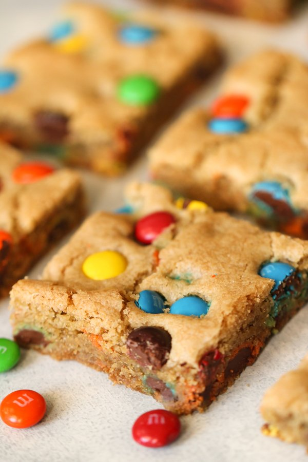 Thick and Chewy M&M Blondies cut into squares
