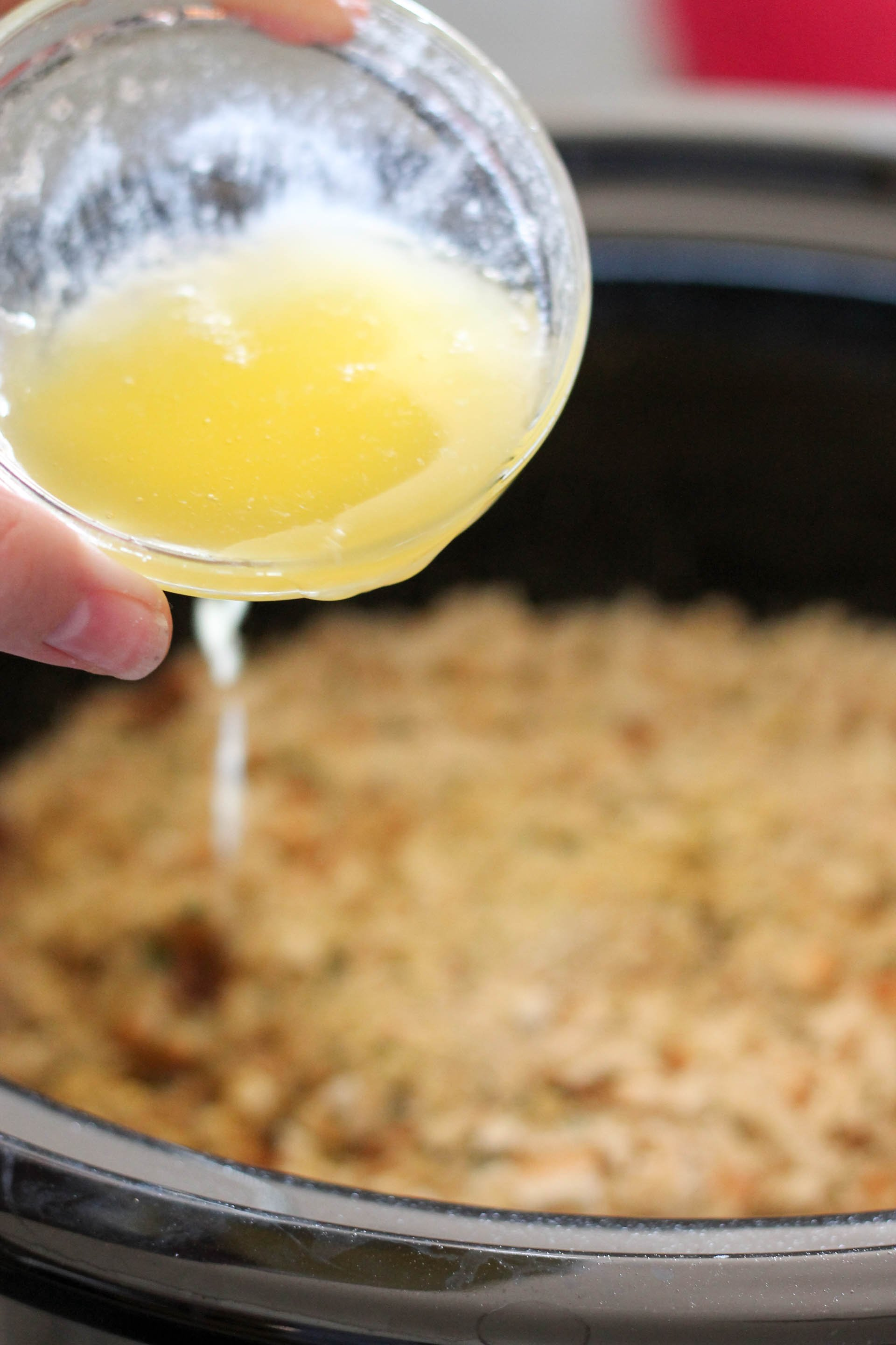 drizzling melted butter on top of everything in the slow cooker