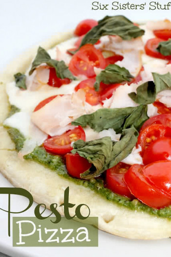 homemade pizza - fresh pesto pizza with tomatoes and basil