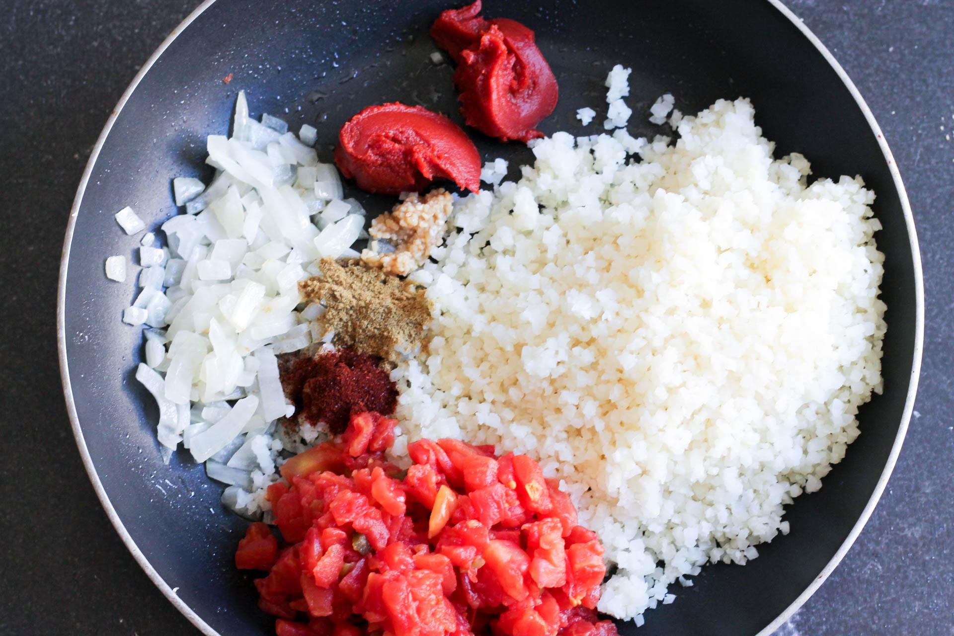 Ingredients for Spanish Cauliflower Rice in skillet