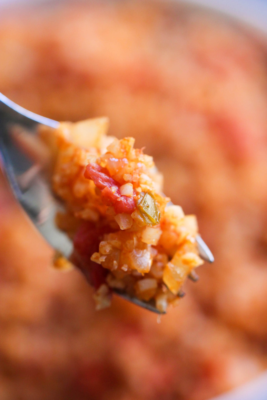 This Spanish cauliflower rice on a fork