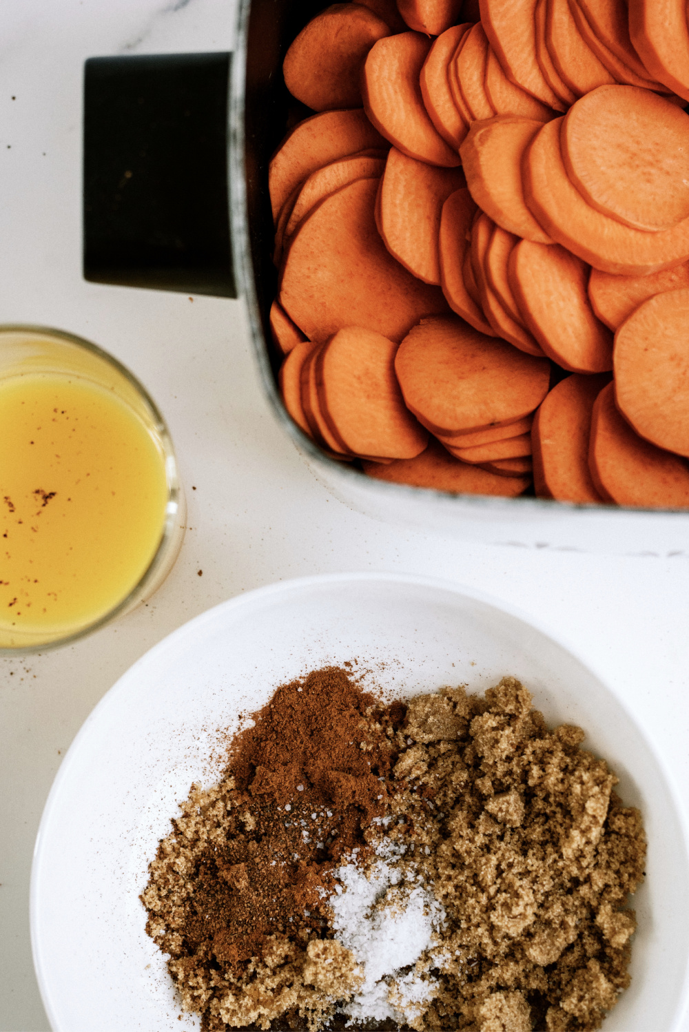 sliced sweet potatoes with brown sugar spices and orange juice