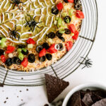 Spooky 7-layer dip served with tortilla chips