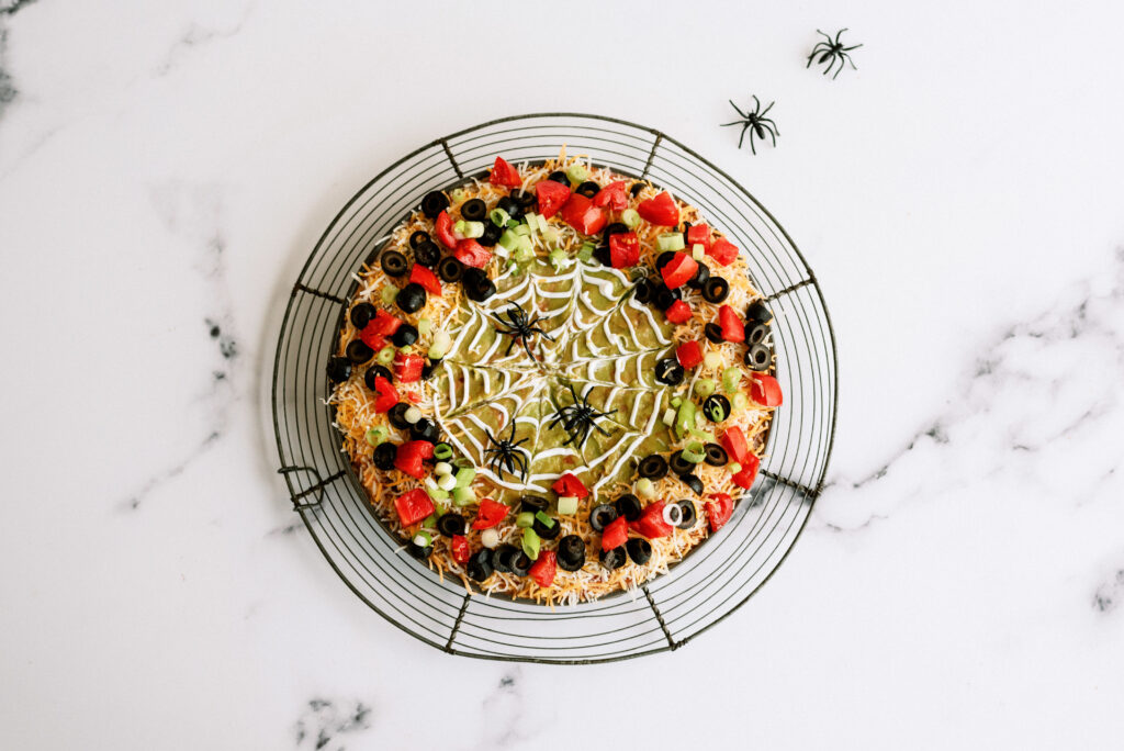 finished spooky 7-layer dip, complete with fake spiders
