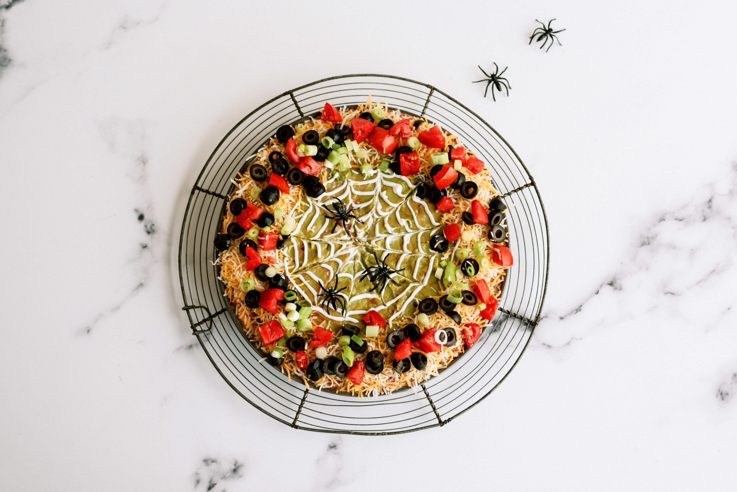 Finished spooky 7-layer dip with fake spiders