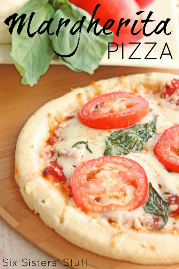 homemade margherita pizza with cheese, basil, and mozzarella