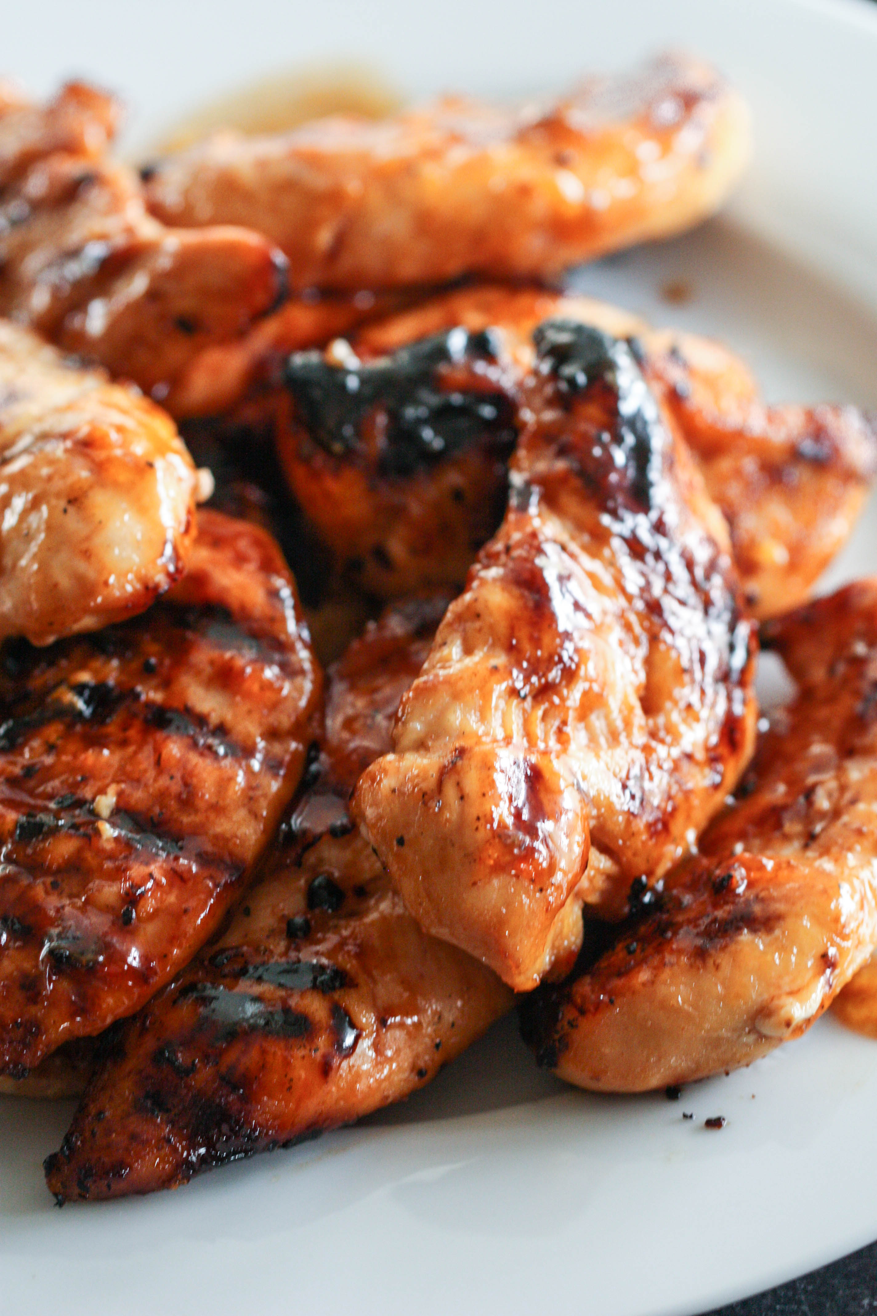Barbecue Peach Chicken Pieces on a white plate
