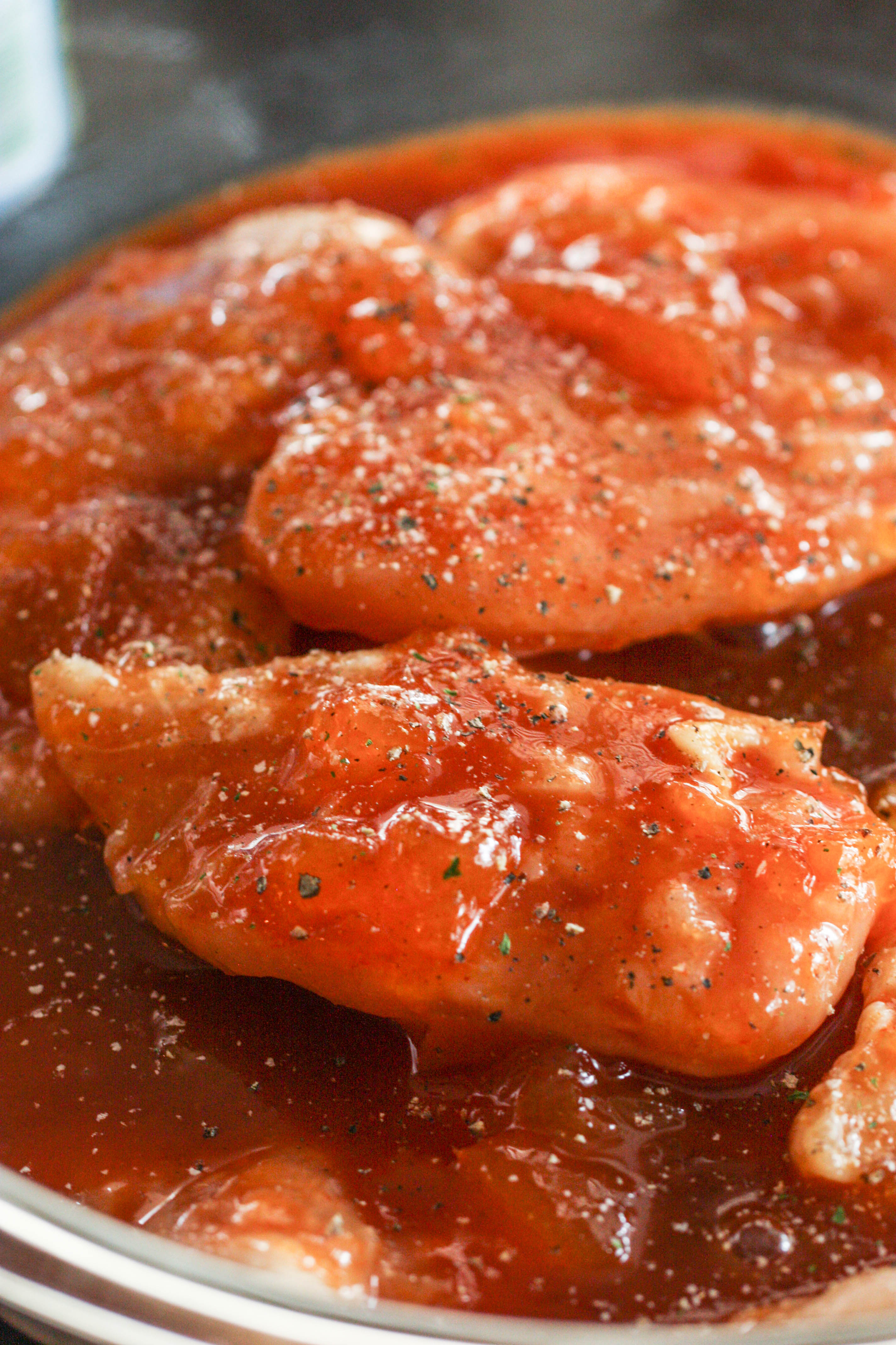 Raw chicken covered with Barbecue Peach Chicken marinade