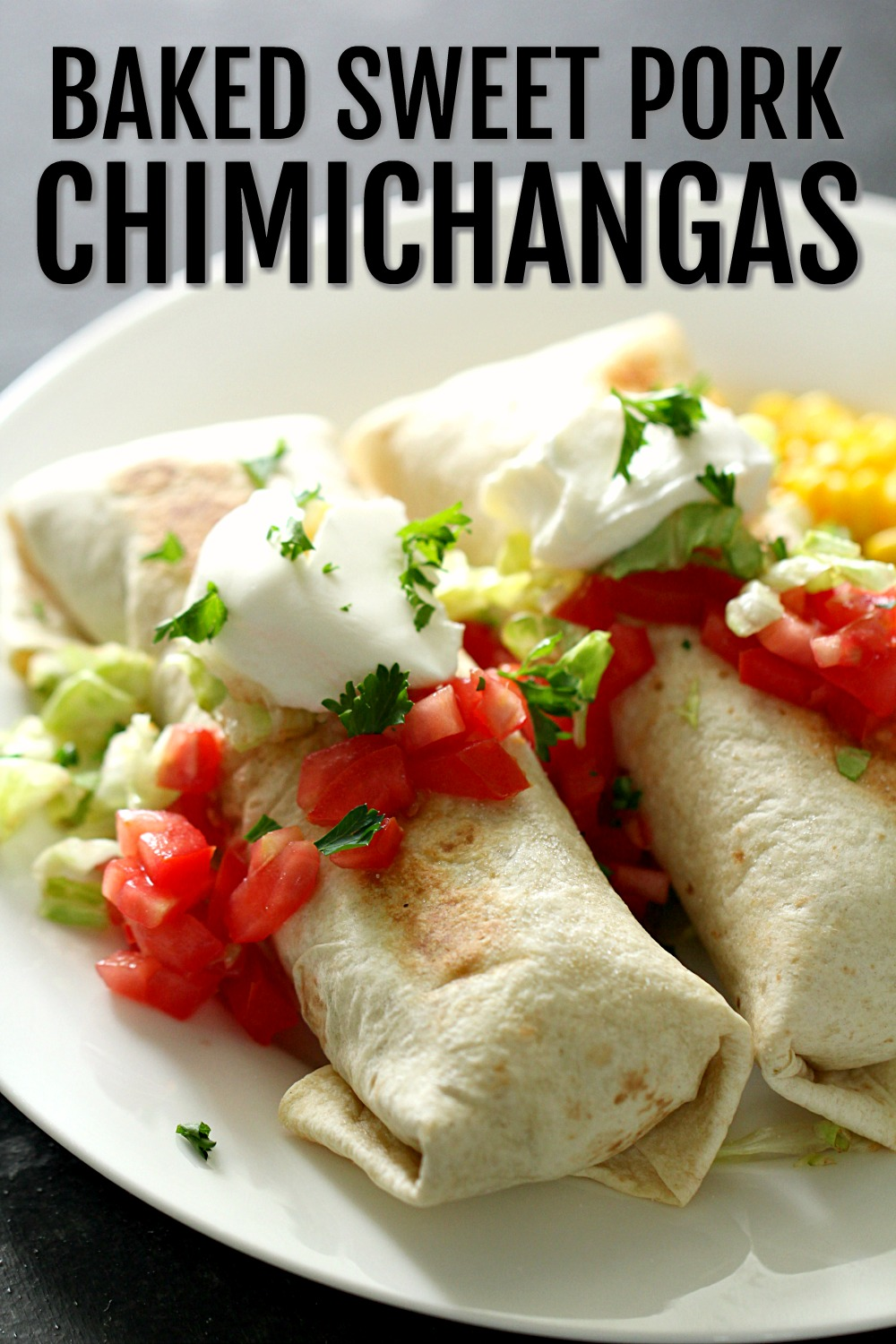 Baked Sweet Pork Chimichangas on a white plate, topped with sour cream and salsa