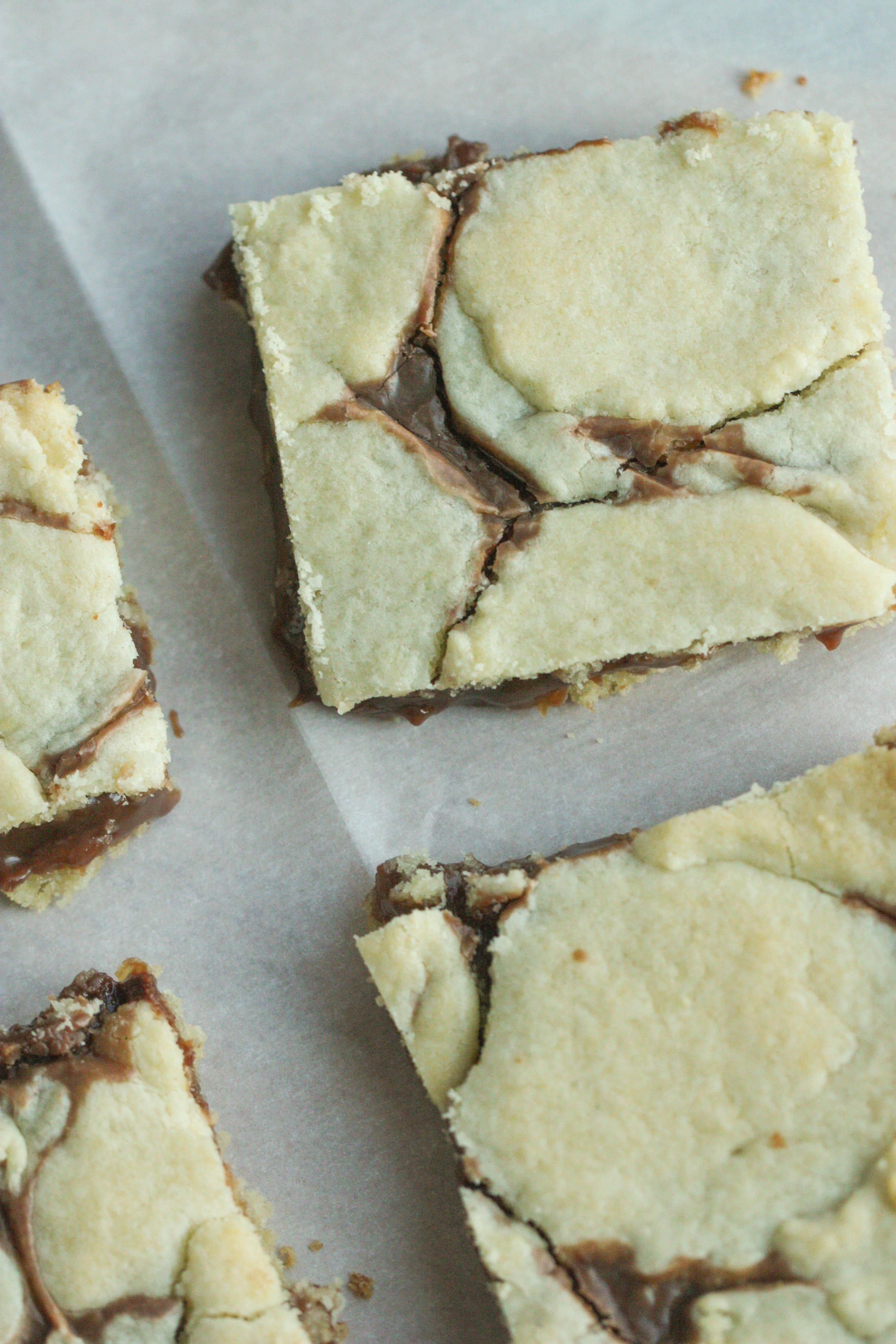 Cake Mix Cookie Bars sliced on parchment paper