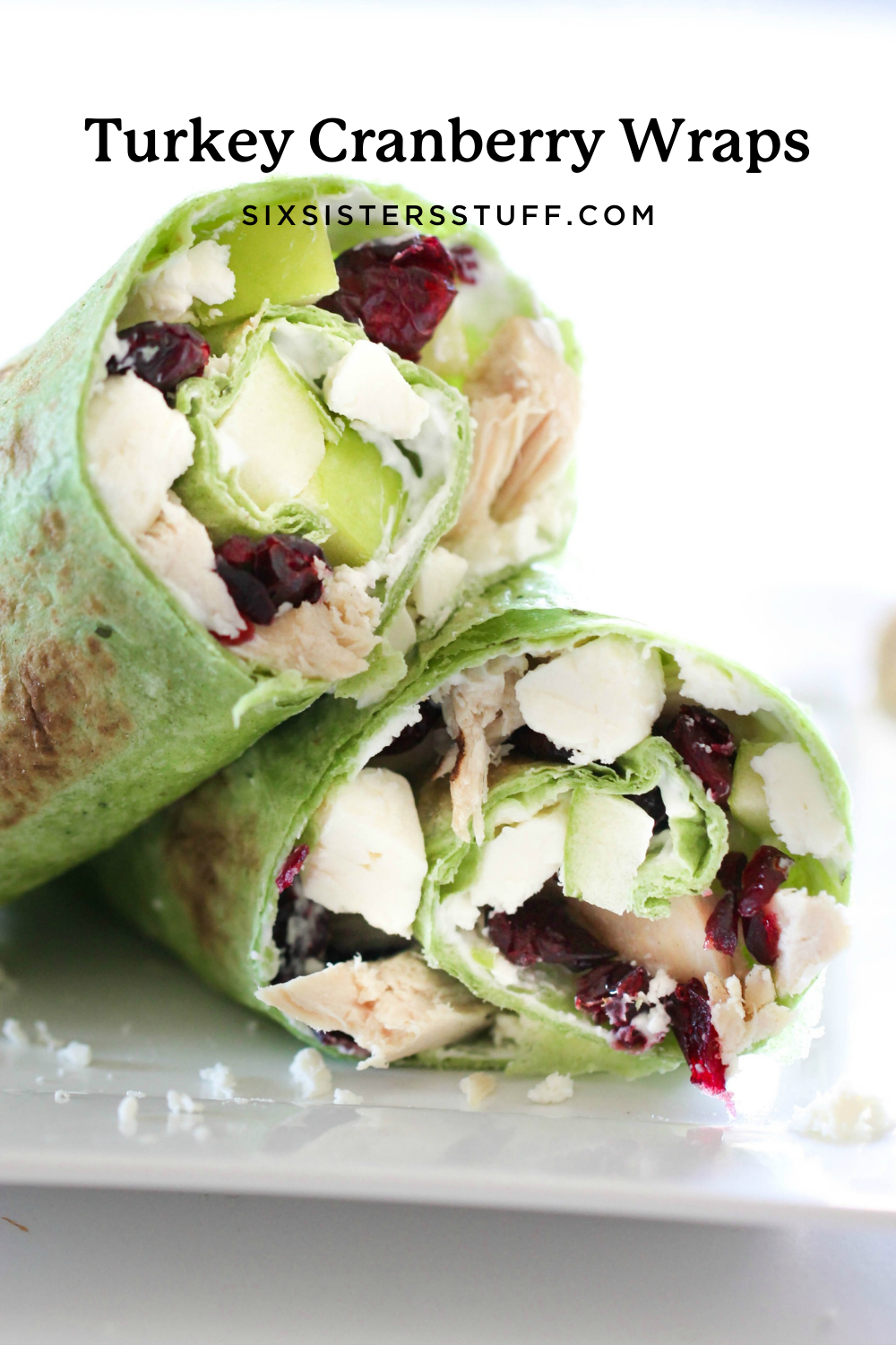 turkey, craisins, apples, and feta cheese wrapped up in a tortilla