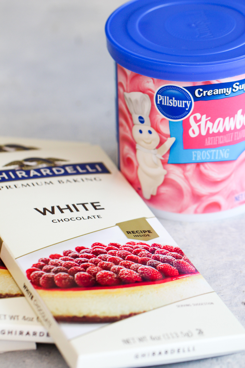 white chocolate bark and strawberry frosting in separate containers