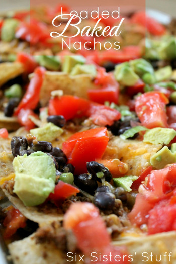 baked nachos with avocado, tomato, and olives