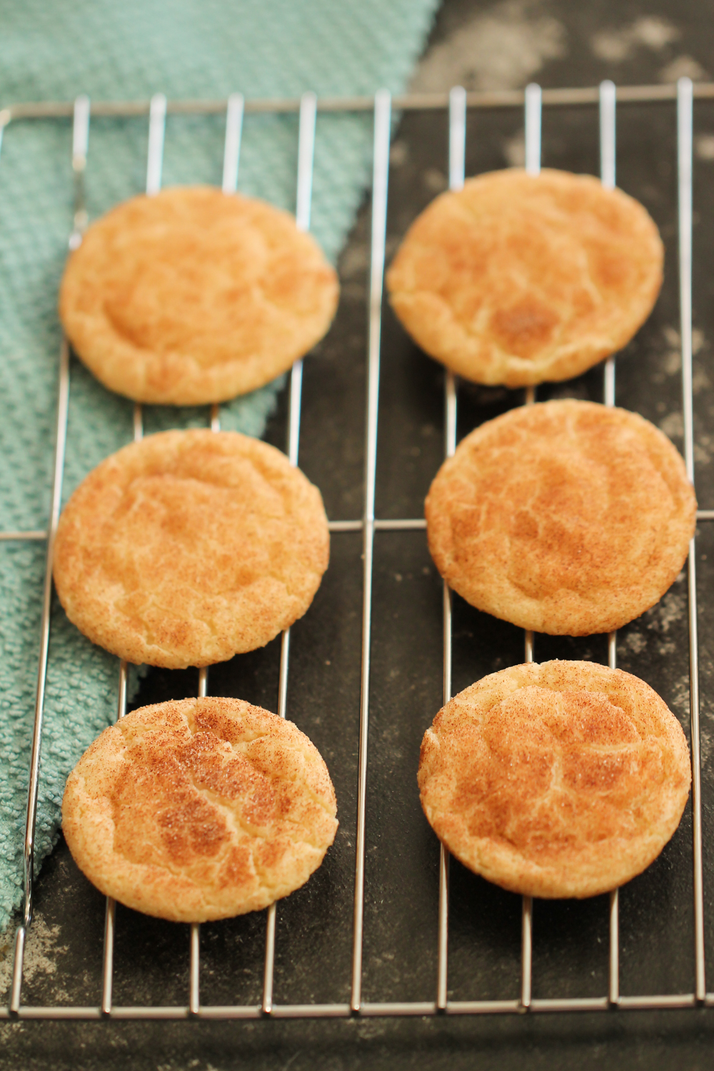 Baked Snickerdoodle cookies on cooling rack
