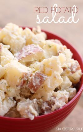 red potato salad with dill in serving bowl