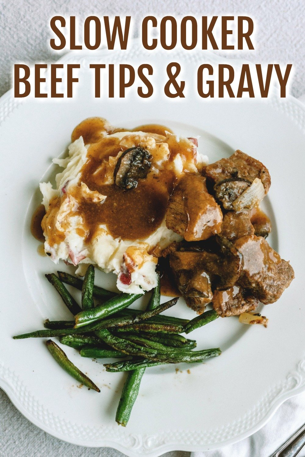 Slow Cooker Beef Sirloin Tips and Gravy served over mashed potatoes with green beans