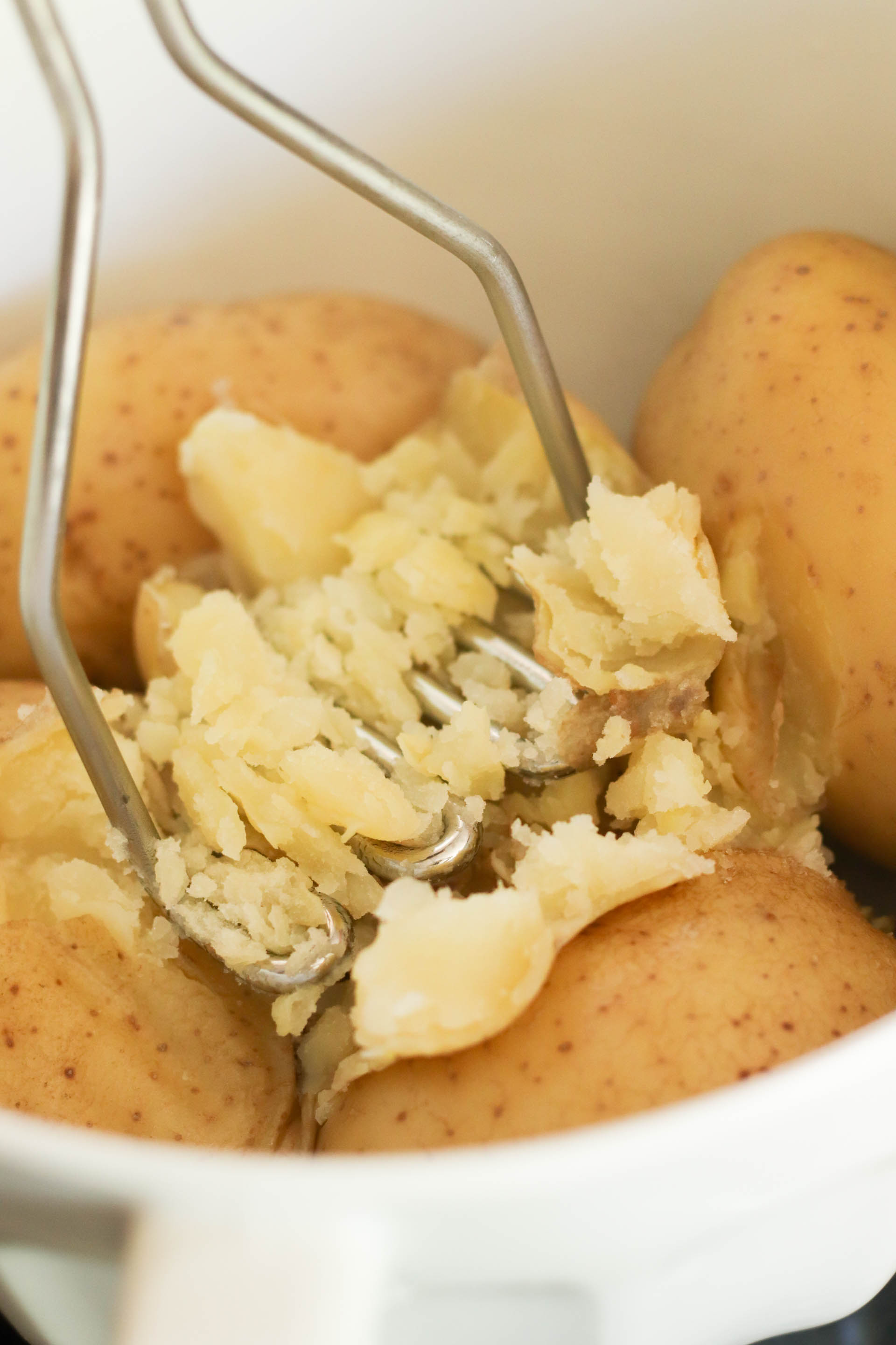 Mashing cooked potatoes