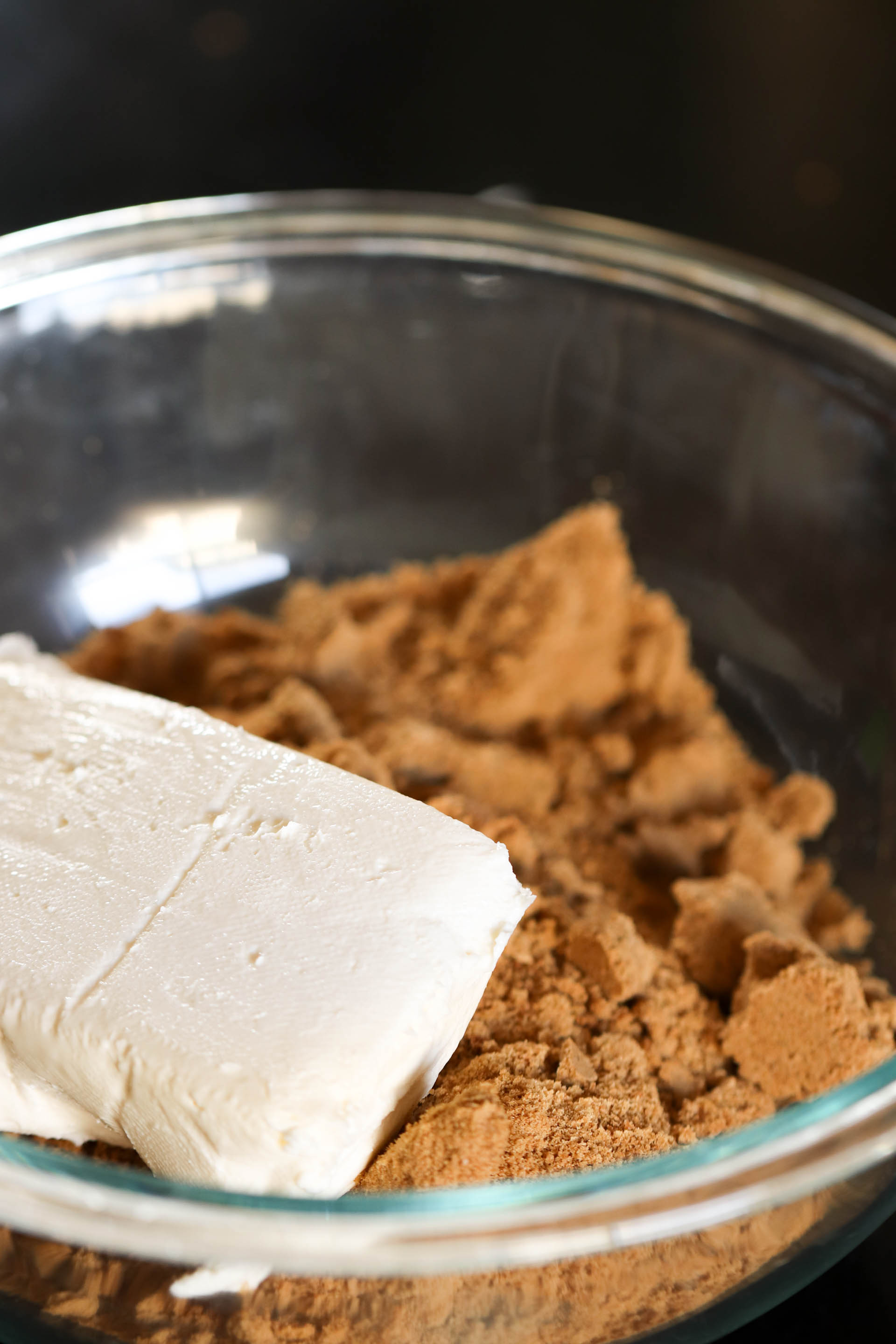 finely ground gingersnap cookies and a block of cream cheese