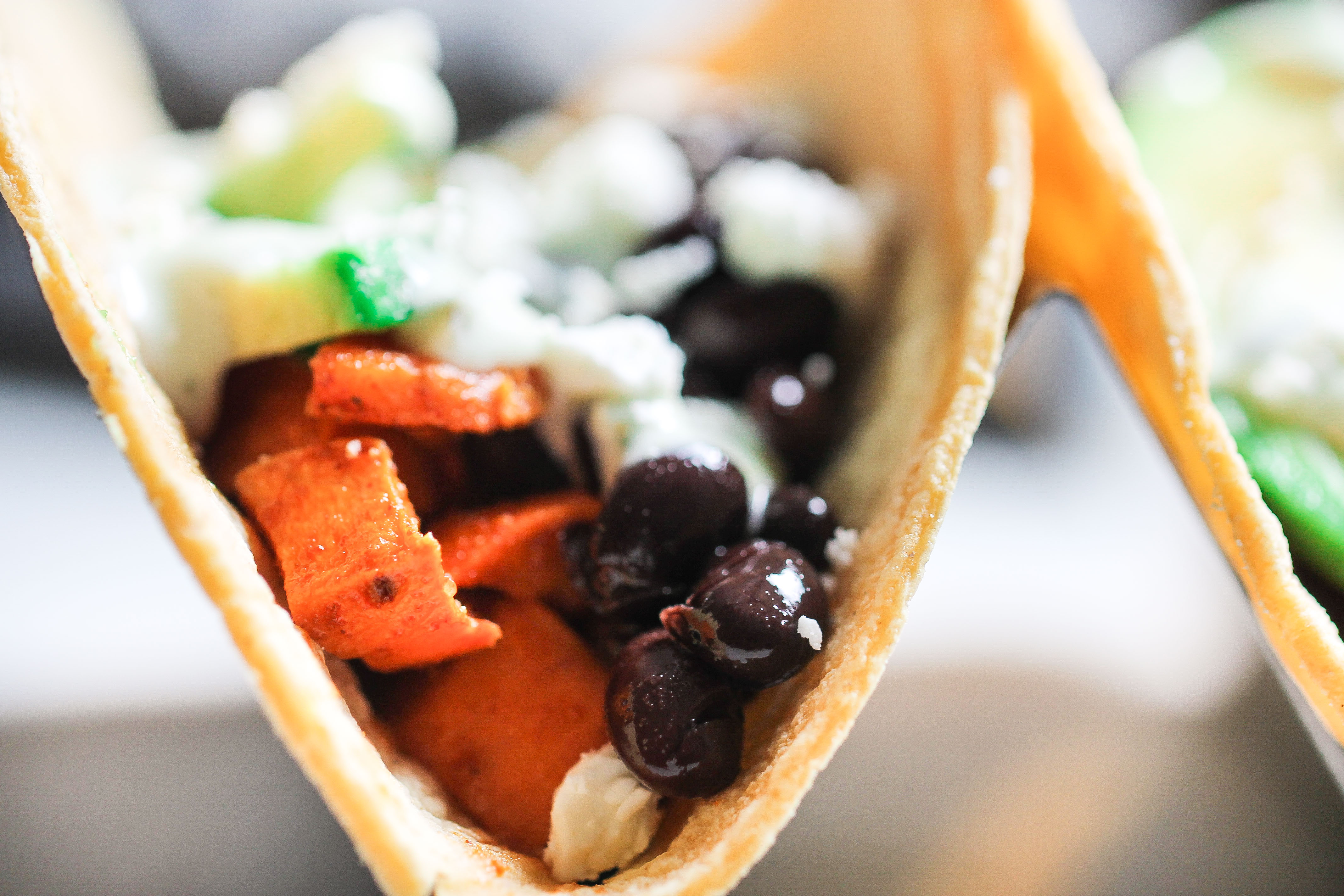 close up picture of black bean sweet potato tacos