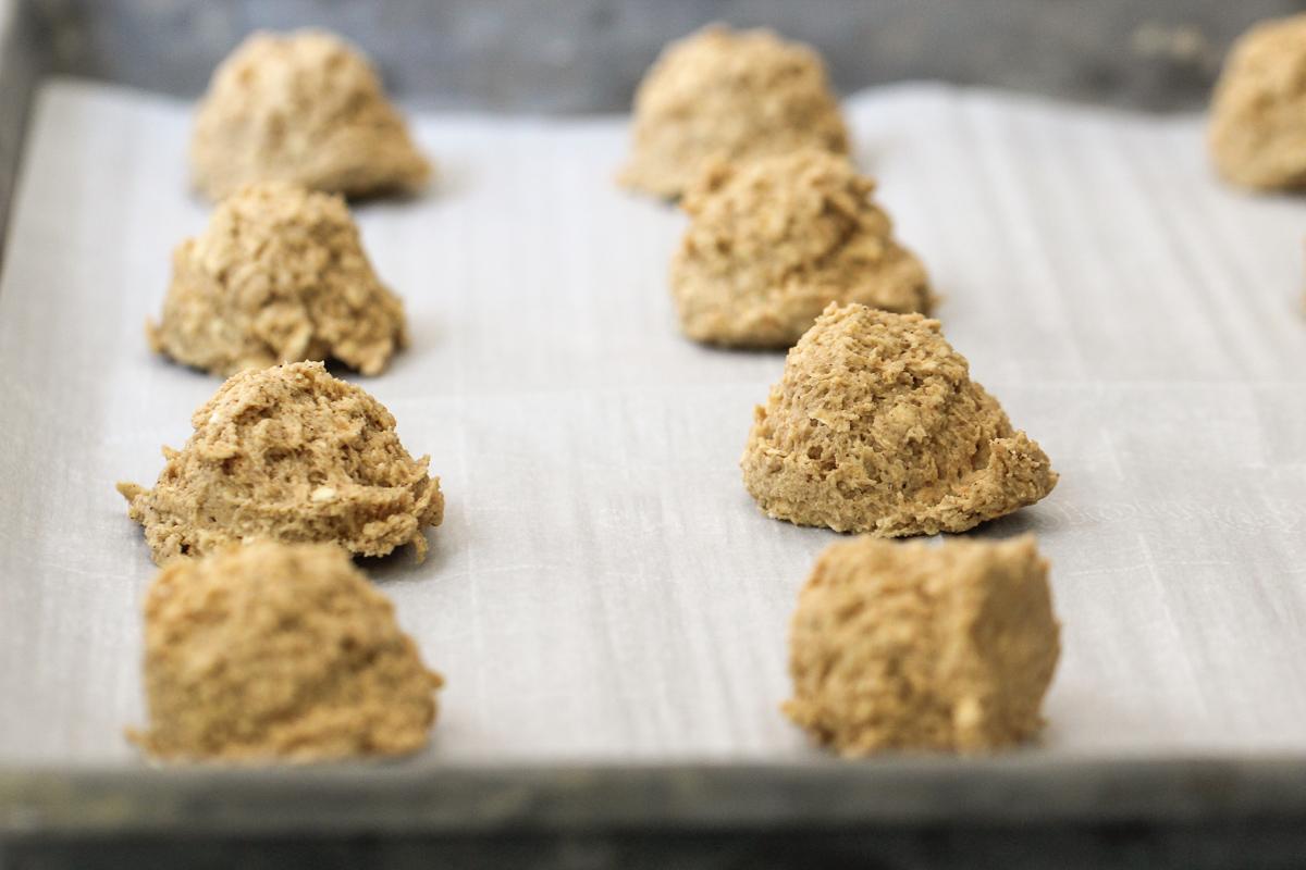 Oatmeal cookie dough on a baking sheet