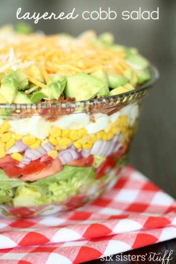 layered cobb salad on red checkered tablecloth