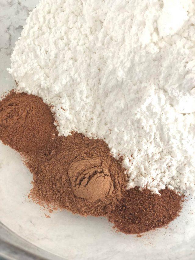 powdered sugar, pumpkin pie spice, cinnamon and nutmeg in a bowl