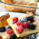 German Pancakes finished with powdered sugar with berries