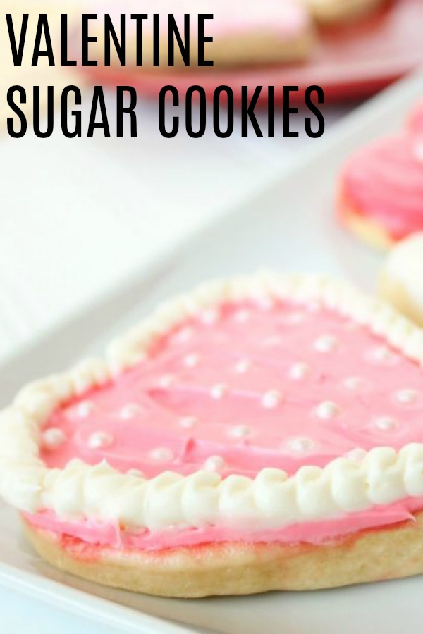 Valentine Sugar Cookie heart shaped with pink and white frosting