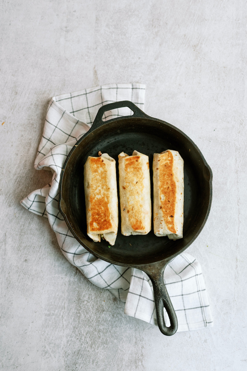 Crispy Bean and Cheese Burritos in a frying pan