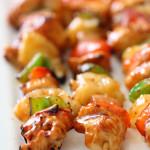 Hawaiian BBQ Chicken Kabobs lined up on platter