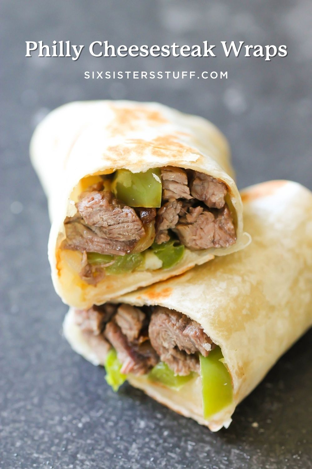 philly cheesesteak wraps with cheese and green pepper and onions
