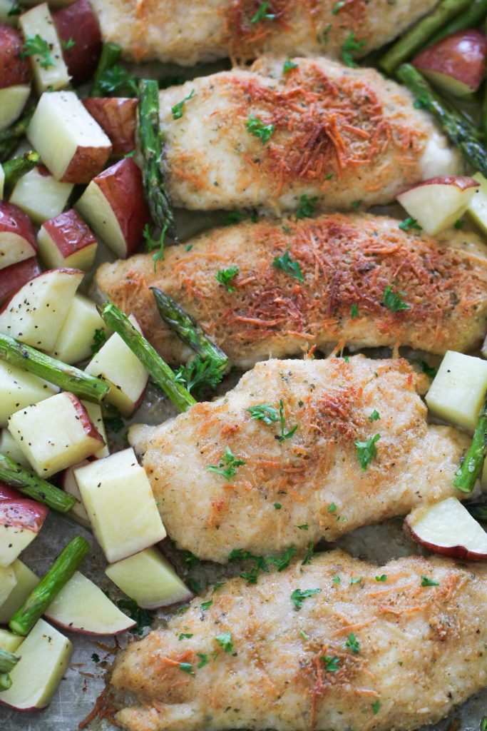 Parmesan Chicken on a sheet pan with potatoes and asparagus