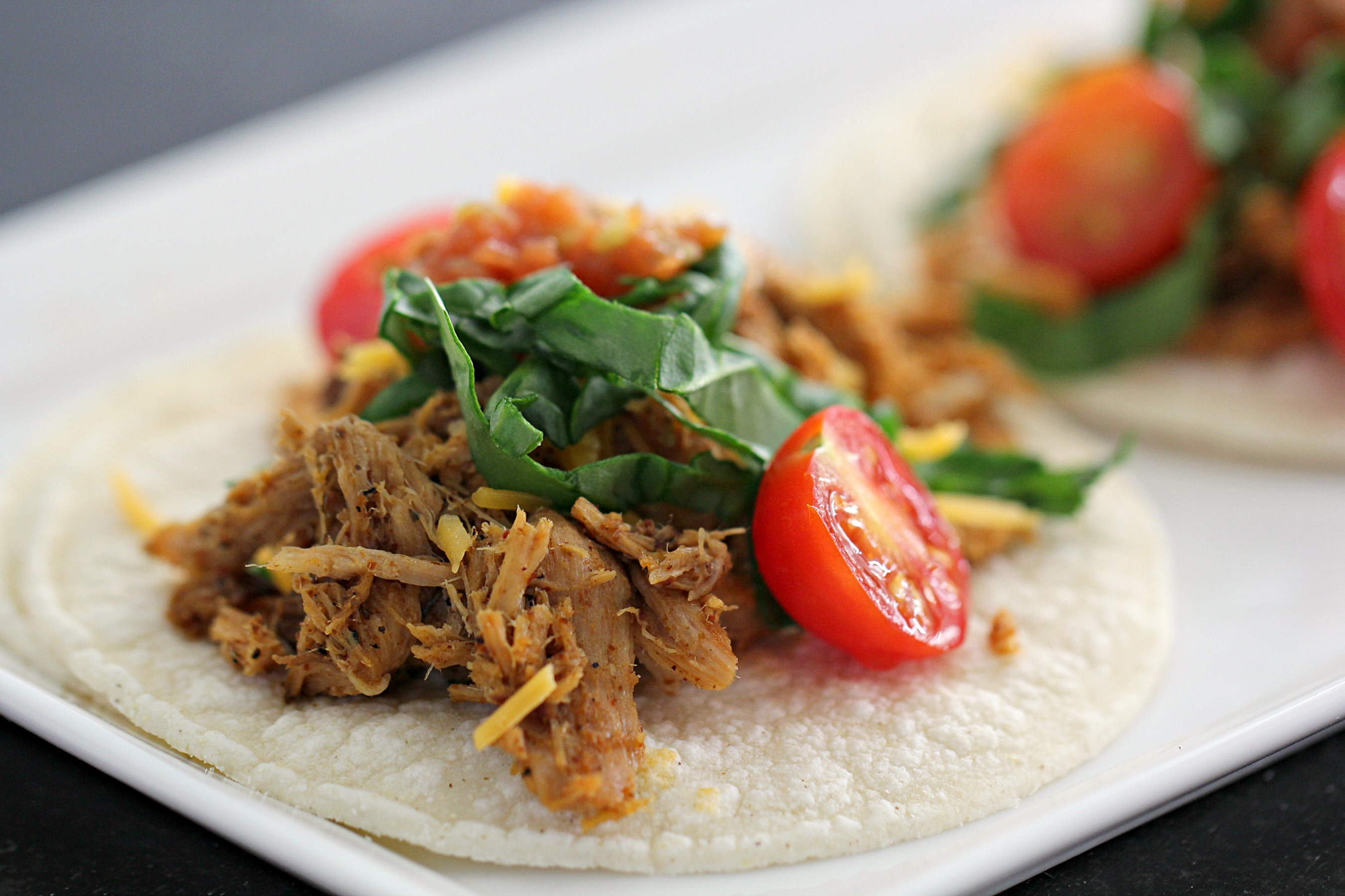 Shredded Mexican Chicken on tortilla topped with Cheese and Veggies