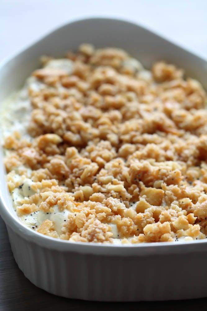 Poppy Seed Chicken Casserole in white casserole dish