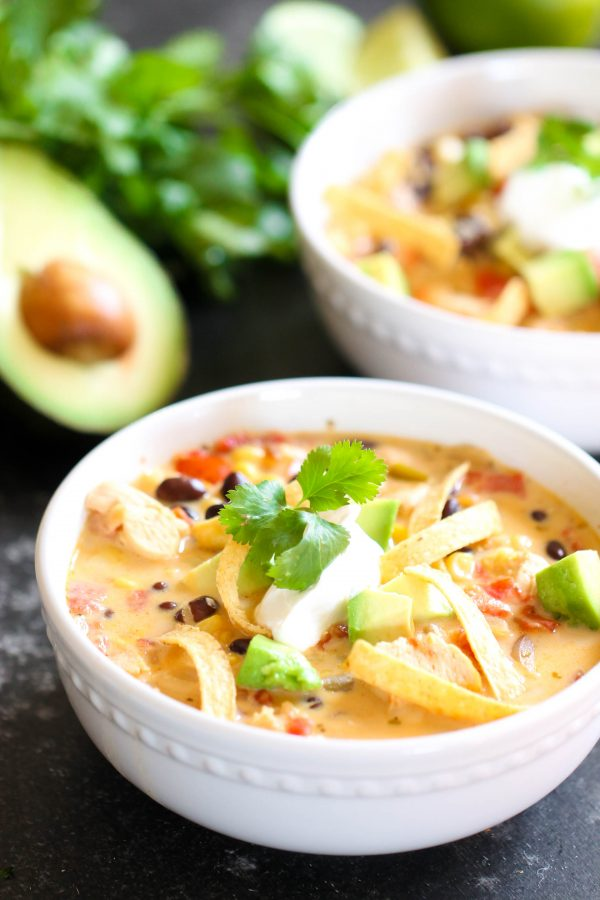 Cheesy Southwest Soup in bowl with toppings