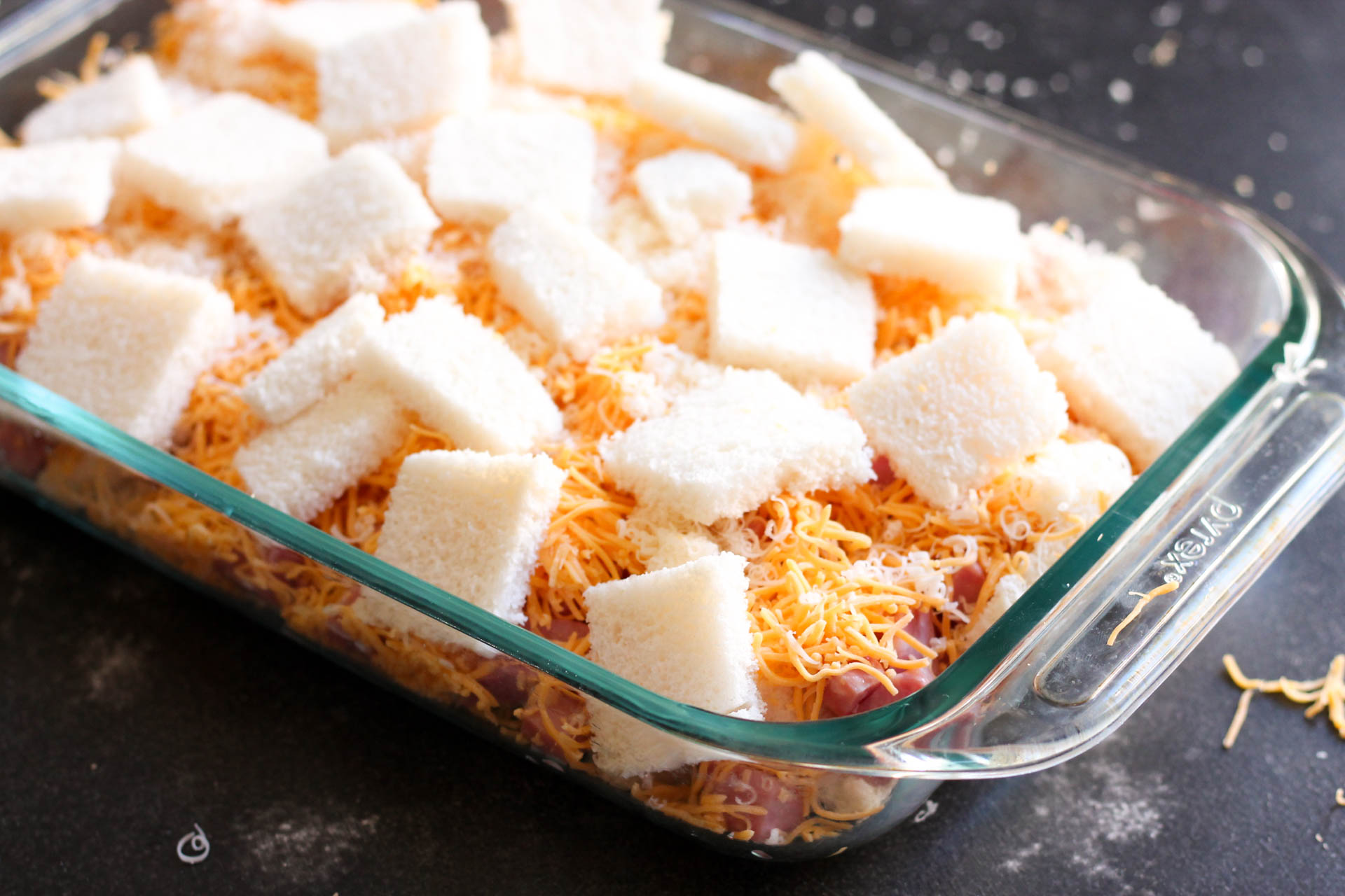 An additional layer of cubed bread for Ham and Cheese Casserole